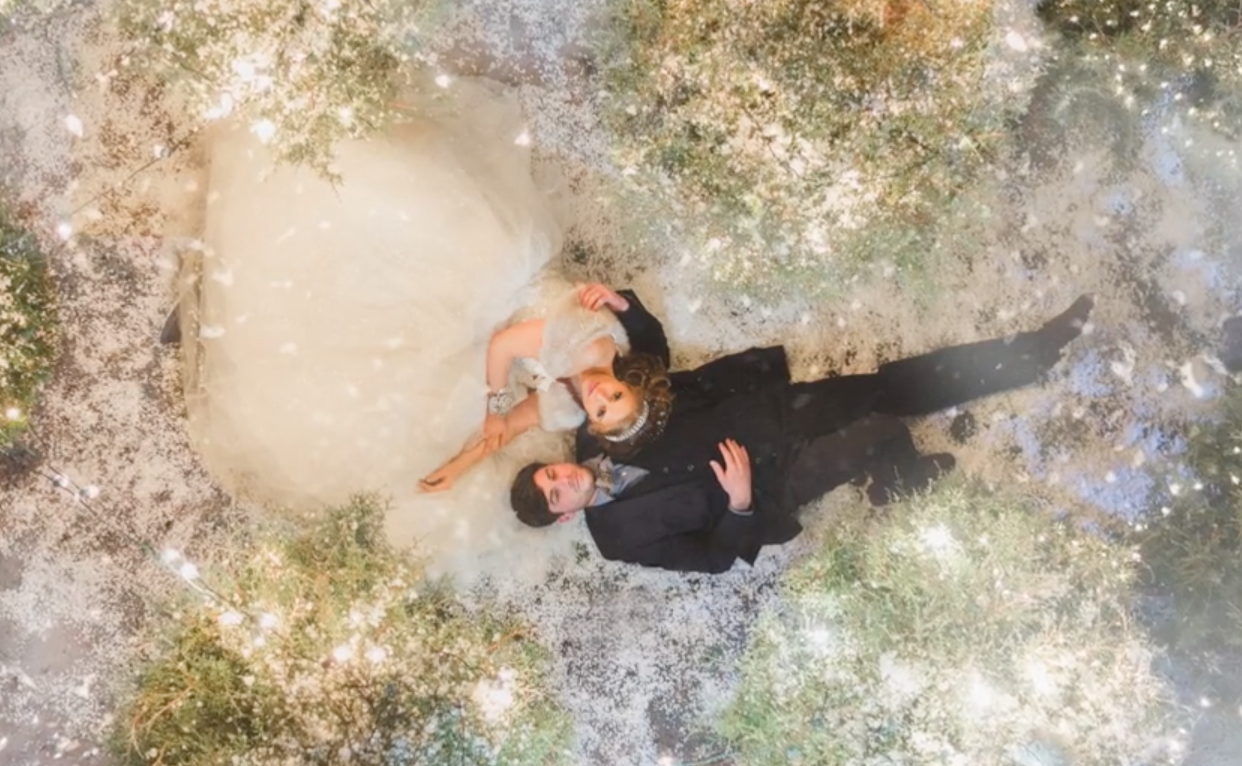 Behind-the-scenes video of a winter wedding night photo shoot
