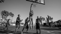 Guys playing basketball in venice beach california